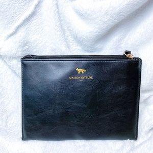 new Maison Kitsune faux leather travel bag